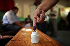 An Egyptian man shows his ink-stained finger after casting his vote at a polling station in Cairo